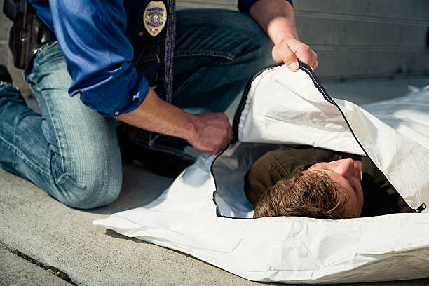 Police Officer with Body Bag stock photo
