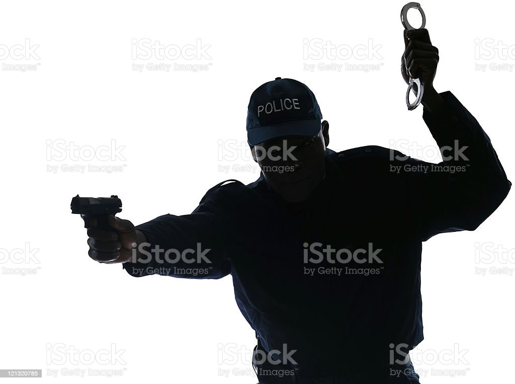 Police officer with handgun and handcuffs stock photo