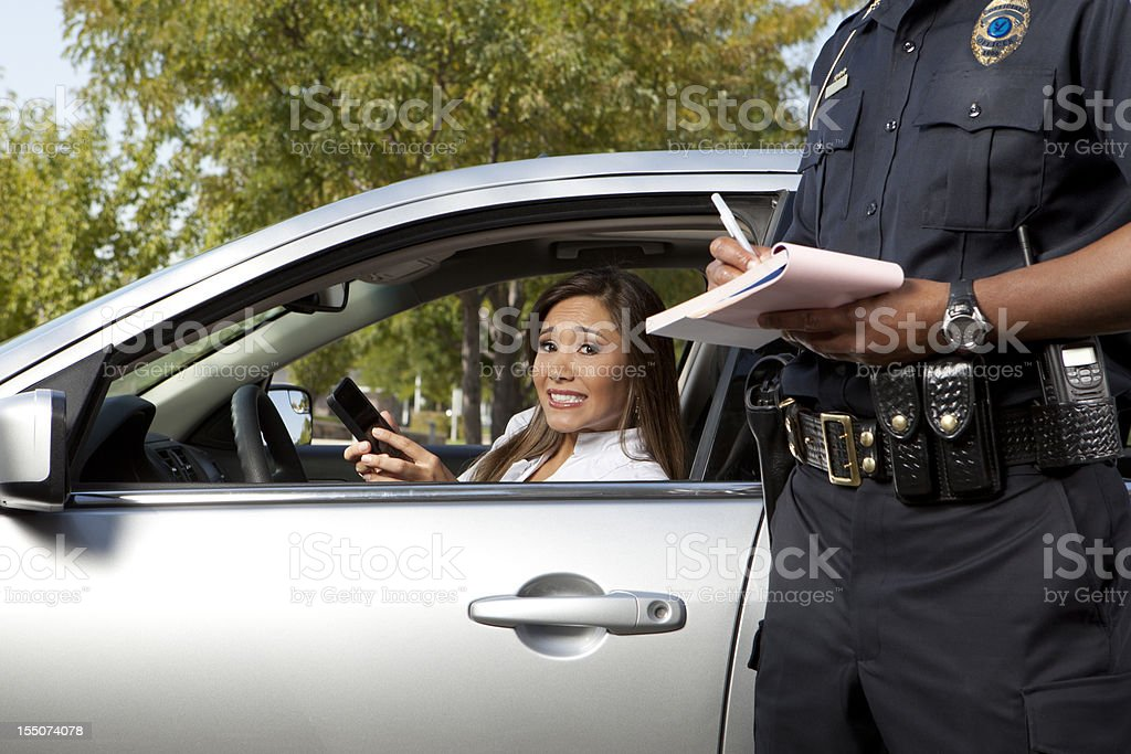 Police Officer writing a traffic ticket stock photo