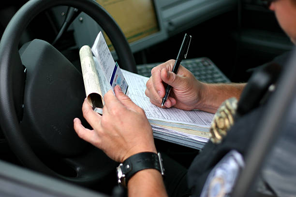 police officer writing ticket 2 - ticket stock photos and pictures
