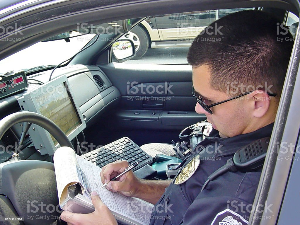 Police Officer Writing Ticket 4 royalty-free stock photo
