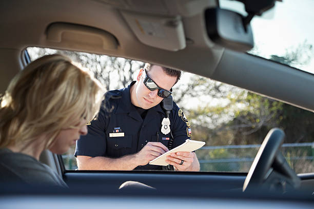 police officer writing ticket - ticket stock photos and pictures