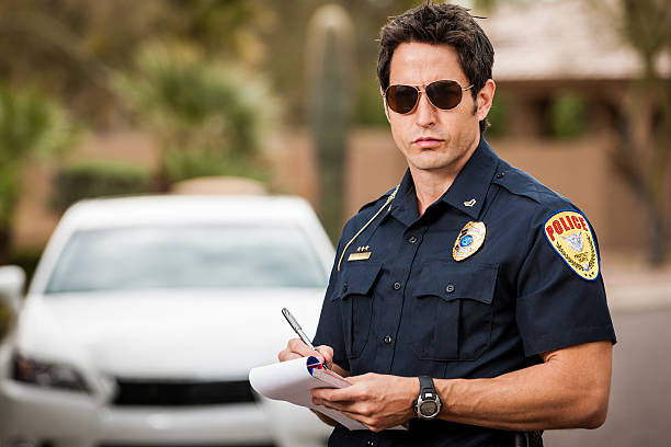Police Officer Writing Traffic Citation stock photo