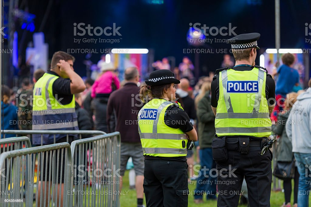 Police officers at a Scottish Music Festival stock photo