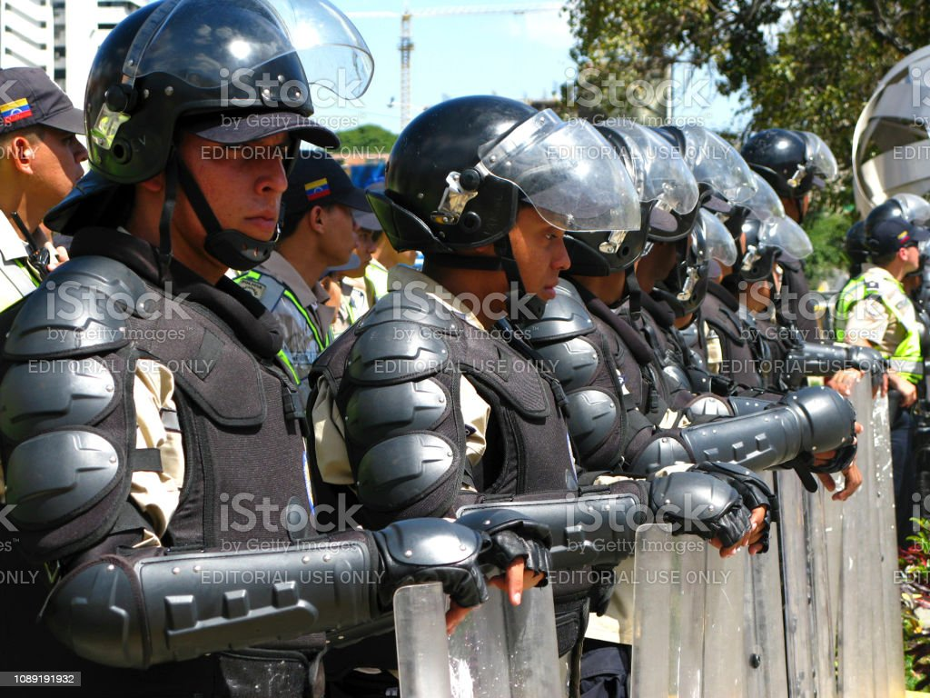 Police officers block a march as Venezuelan opposition activists march in Caracas to keep pressure over Nicolas Maduro government Caracas, Venezuela-May 12, 2017: Riot police block a march in an almost daily series of sometimes deadly protests against the government of President Nicolas Maduro Accidents and Disasters Stock Photo