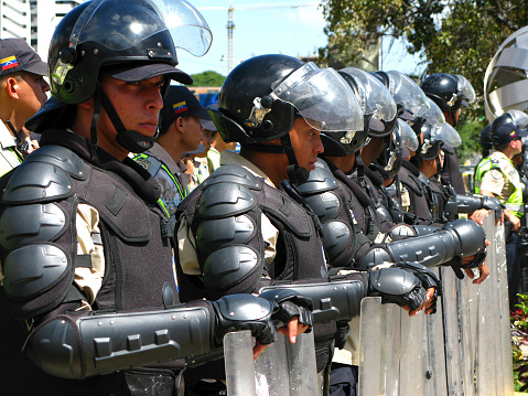 Police Officers Block A March As Venezuelan Opposition Activists March In Caracas To Keep Pressure Over Nicolas Maduro Government Stock Photo - Download Image Now