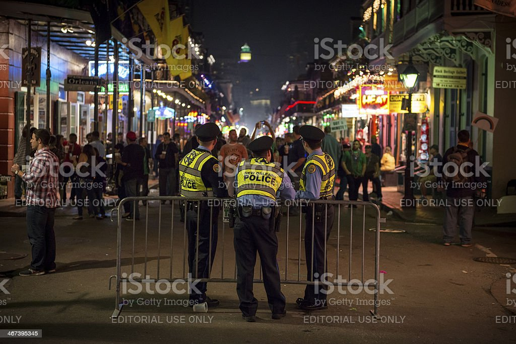Police officers on Bourbon Street during Mardi Gras stock photo