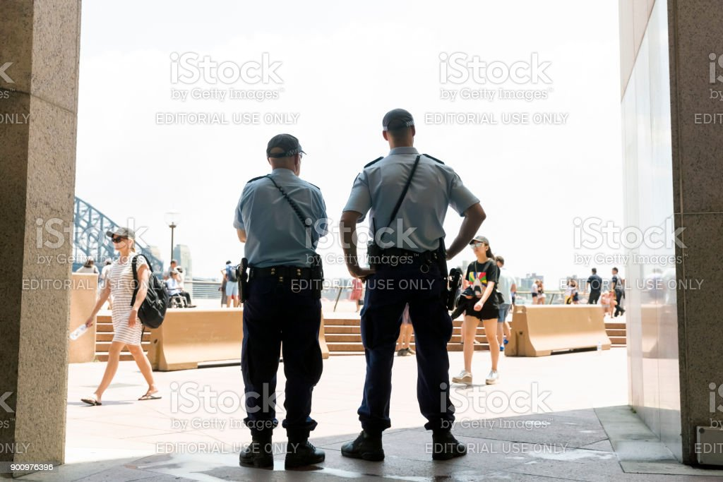 Police officers patrol the street in Sydney, copy space stock photo