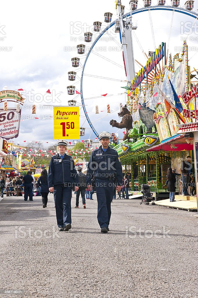 Police Officers Patrolling Amusement Park royalty-free stock photo