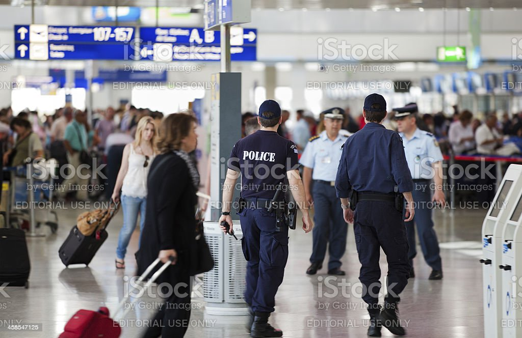Police officers patrolling in Athens International Airport, Greece. stock photo