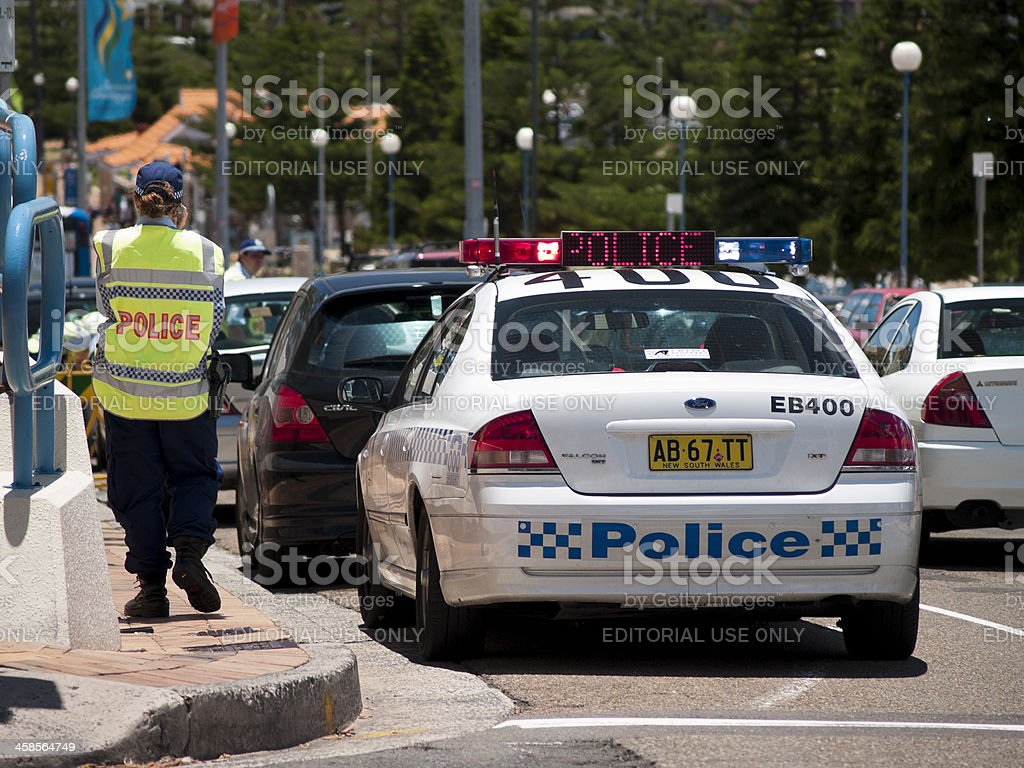 Police officers patrols the beachside suburb of Coogee, Sydney stock photo