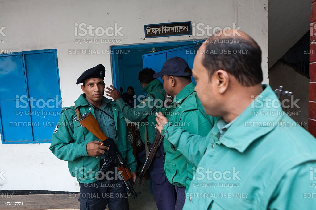 police officers standing guard in Dhaka stock photo