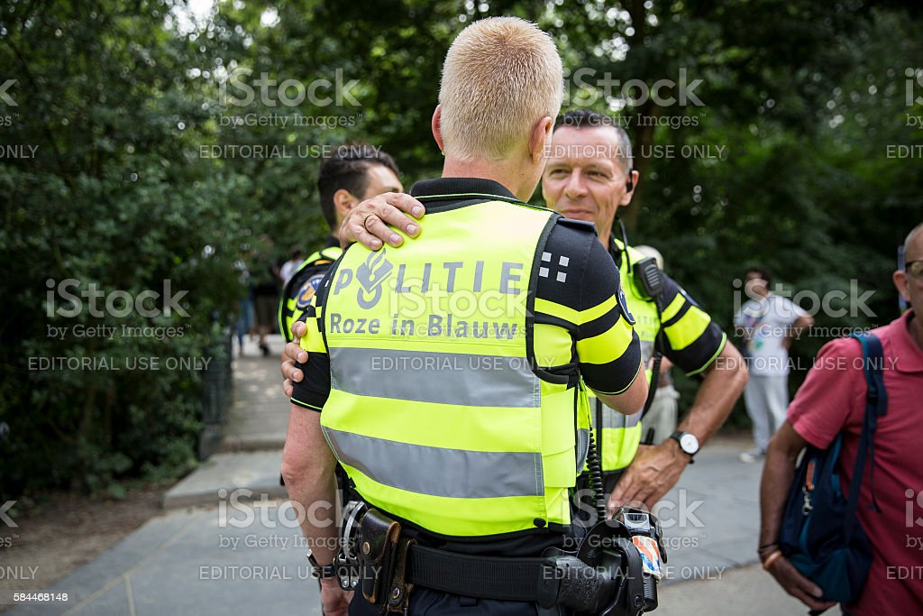 police officers with a vest saying 'blue in pink', EuroPride stock photo