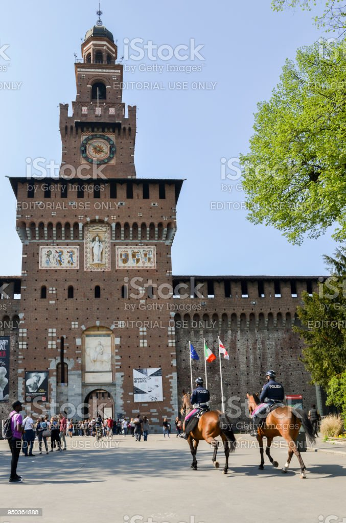 Police on horses in front of a medieval tower stock photo