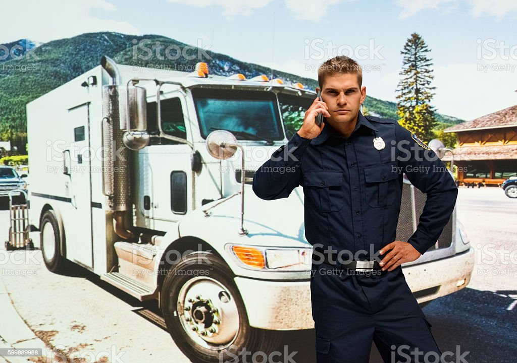 Police on phone outdoors stock photo