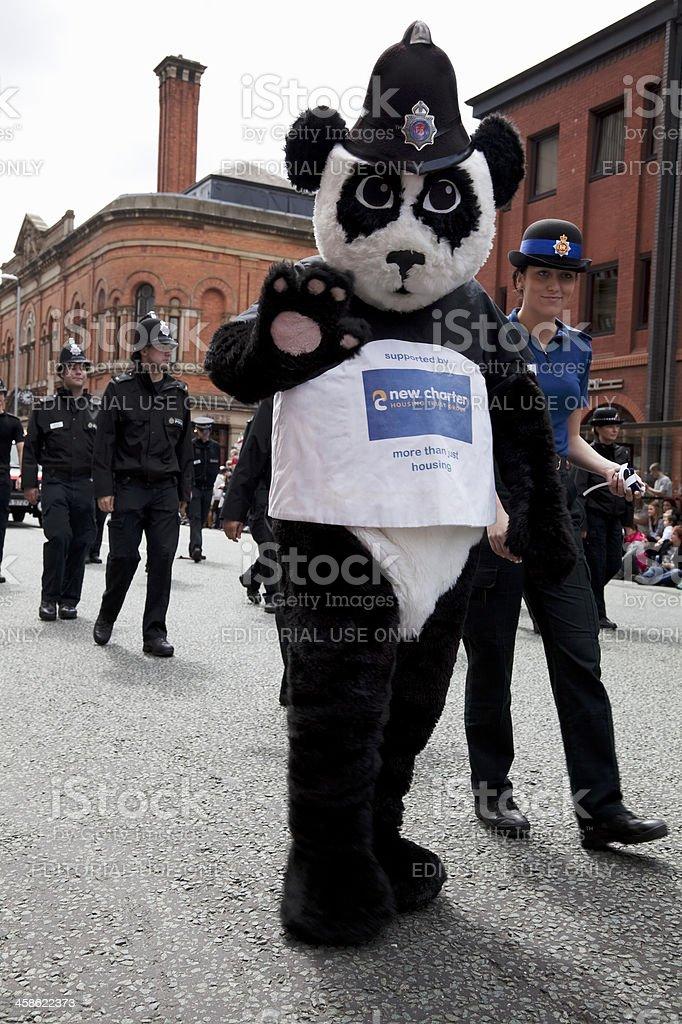 Police panda costume, waving at the crowd stock photo
