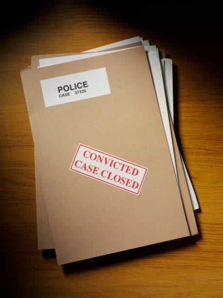 police paper files on a desk - murder mystery stock photos and pictures