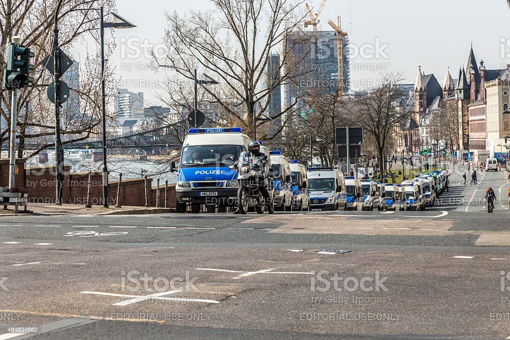 police parks cars near demonstration against EZB and Capitalism stock photo