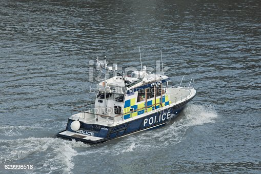 London, United Kingdom - November 19, 2016: Police patrol boat on Thames. The Marine Policing Unit (MPU) are responsible for policing 47 miles of the River Thames between Dartford and Hampton Court.