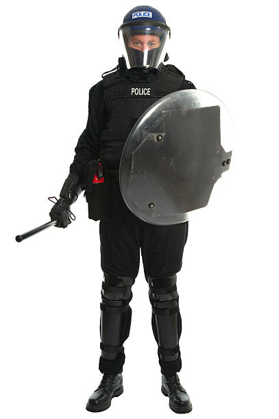 Police riot officer Policeman in full riot gear. riot police stock pictures, royalty-free photos & images
