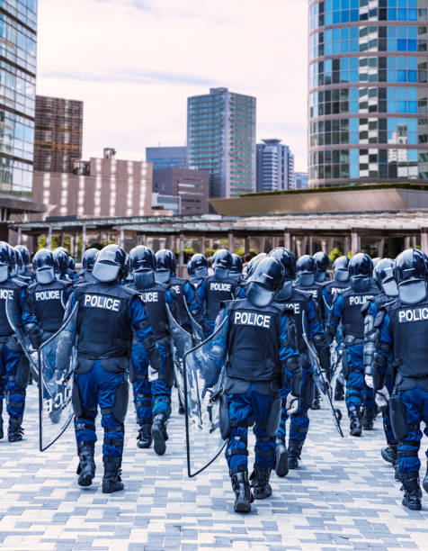 Police riot police protecting the peace of the city Police riot police protecting the peace of the city riot police stock pictures, royalty-free photos & images
