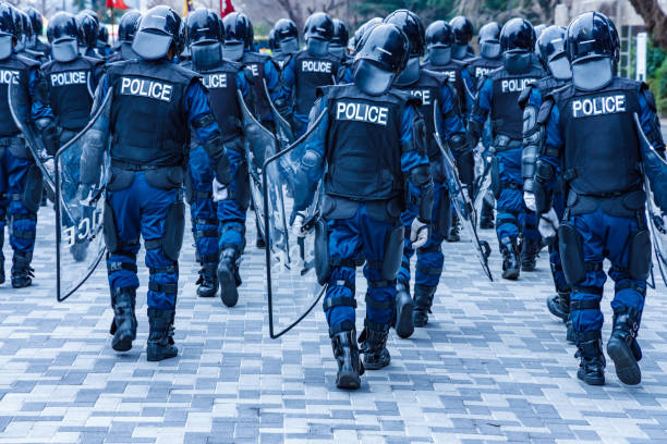 Police riot police protecting the peace of the city Police riot police protecting the peace of the city uniform cap stock pictures, royalty-free photos & images