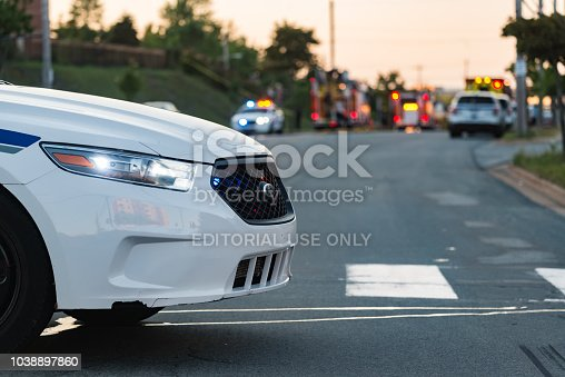 Halifax, Canada - July 31, 2017 - A Halifax Regional Police cruiser blocks Parkland Drive on the scene of a devastating house fire in Clayton Park.