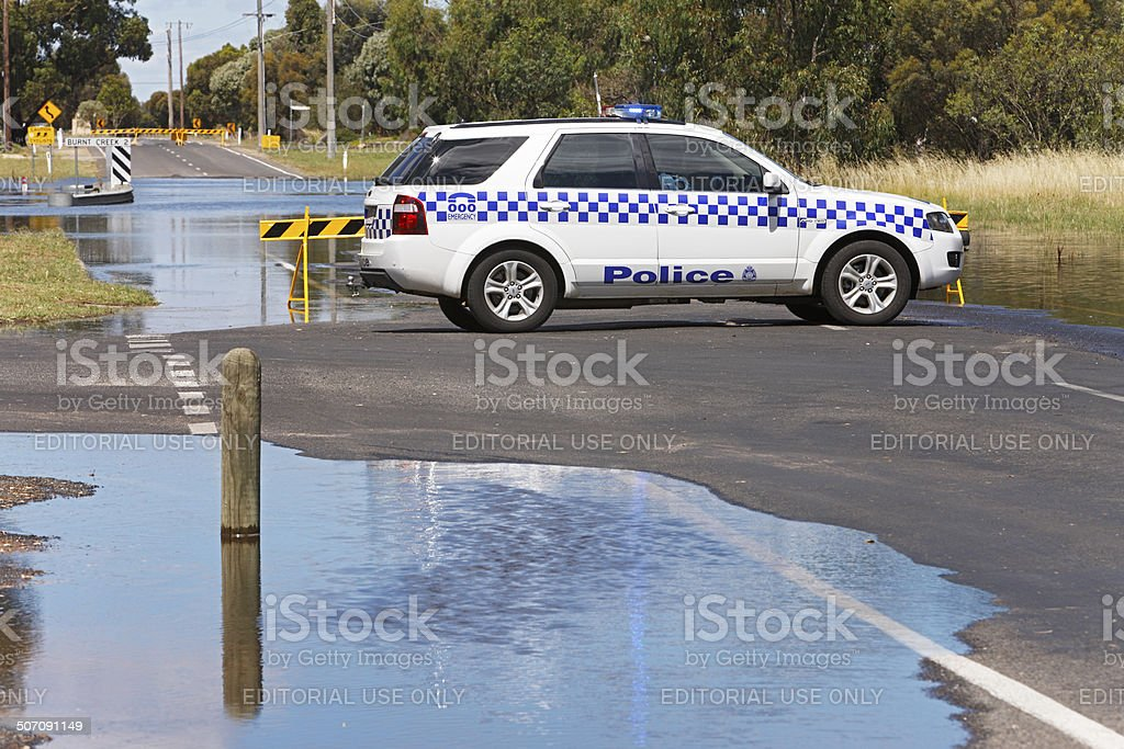 Police roadblock protects flooding road stock photo