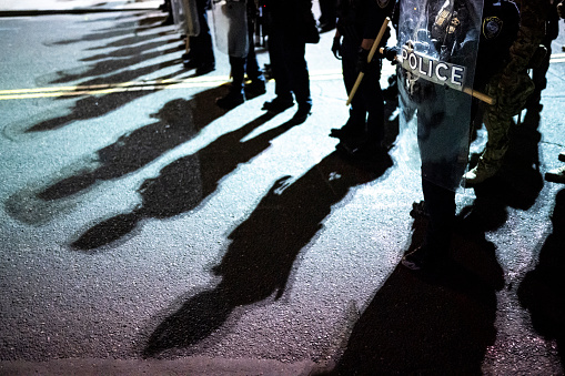 Police shields and shadows at activist protest
