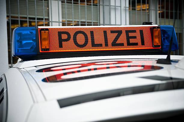 police siren in front of prison stock photo