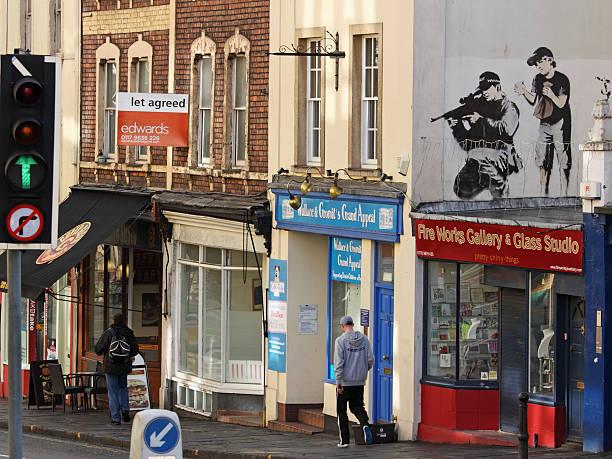 Polizia CECCHINO come descritto dalla street artist Banksy, Bristol - foto stock