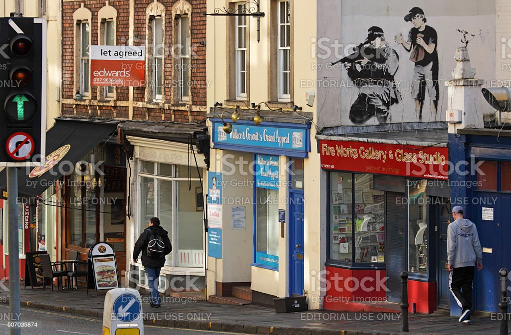 Police sniper taking aim as depicted by Banksy in Bristol stock photo