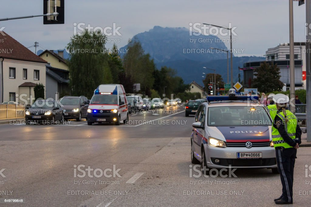 Police stands guard at a roadblock, police car bloc accident. stock photo
