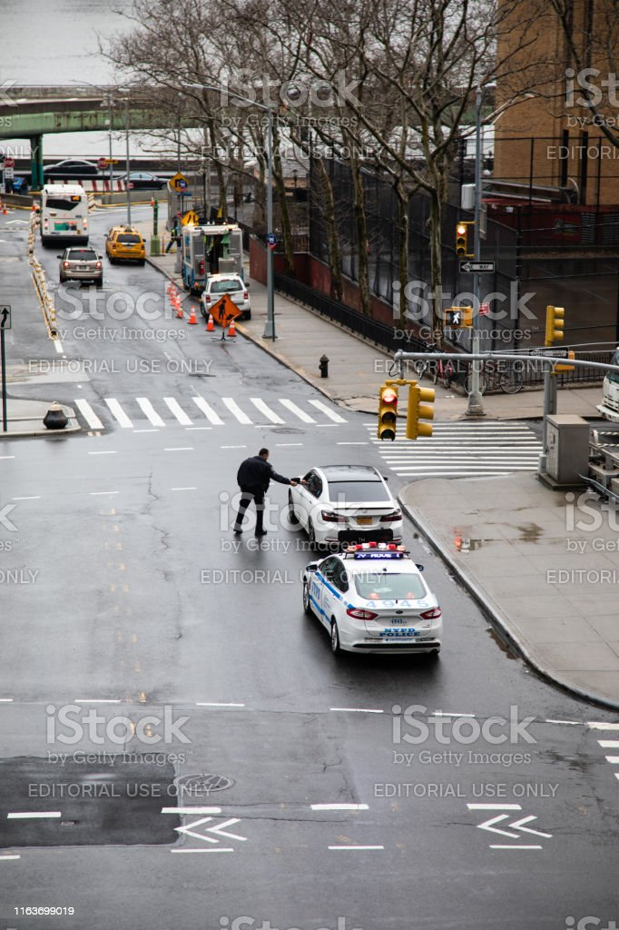Coney Island, United States - February 8, 2019: Police stop car for a...