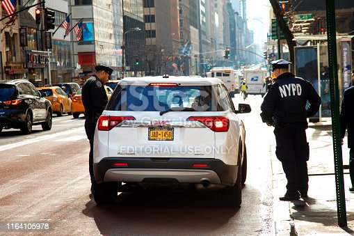 New York City, United States - February 8, 2019: Police stop car for a control in east midtown of Manhattan