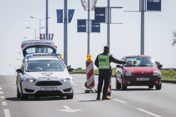 Police stop cars due to coronavirus restrictions stock photo