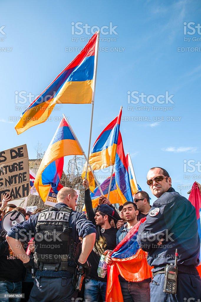 Police surveilling Azerbaijan Armenia conflict protest stock photo