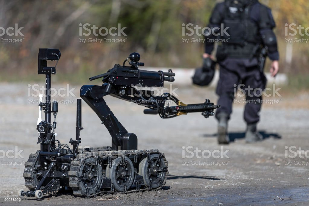 Police Swat Officer Using a Mechanical Arm Bomb Disposal Robot Unit stock photo