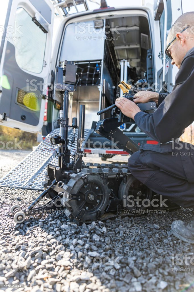 Police Swat Officer Using A Mechanical Arm Bomb Disposal Robot Unit Stock  Photo - Download Image Now