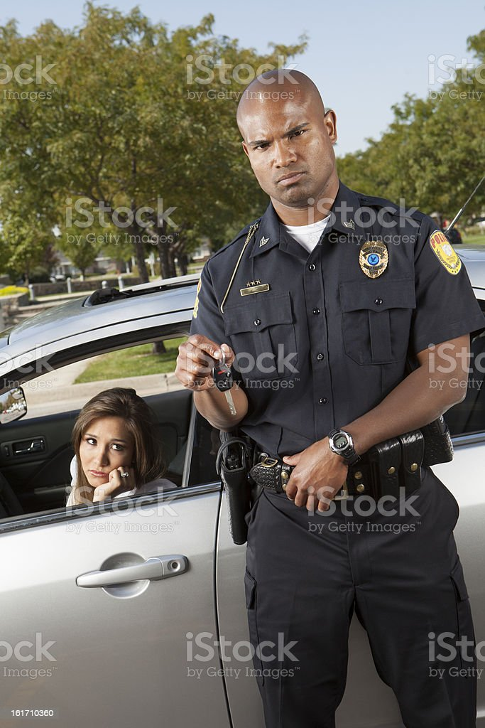 Police Taking Away Keys During Traffic Stop Displeased Woman stock photo