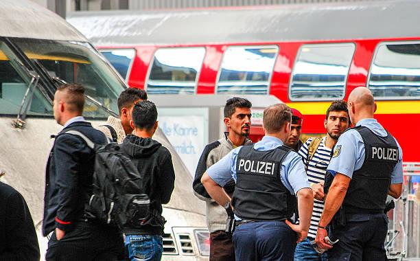 police talk to several migrants that arrived by train - munich train station bildbanksfoton och bilder