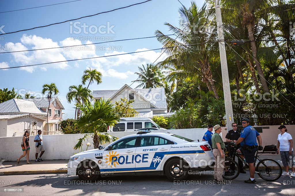 Police talking to tourists on Key West street, Florida, USA stock photo
