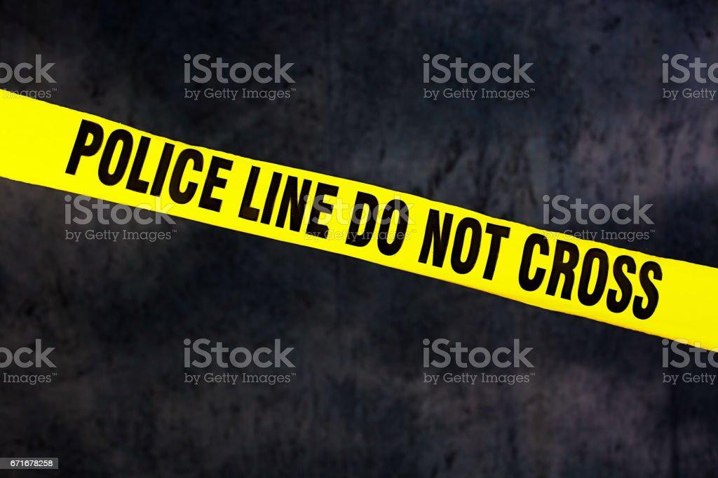 Police tape at crime scene warning not to cross stock photo