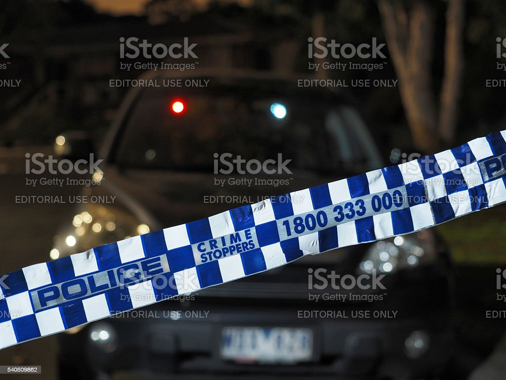 Police tape cordoning off a car after dark stock photo
