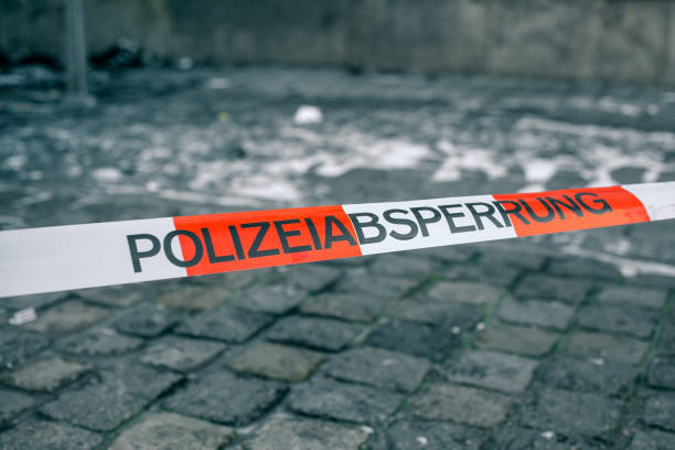 police tape in germany at the crime scene with the inscription in german police cordon. crime scene. - barricata foto e immagini stock