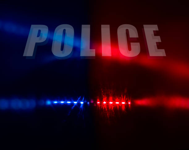 Police text over red and blue lights stock photo