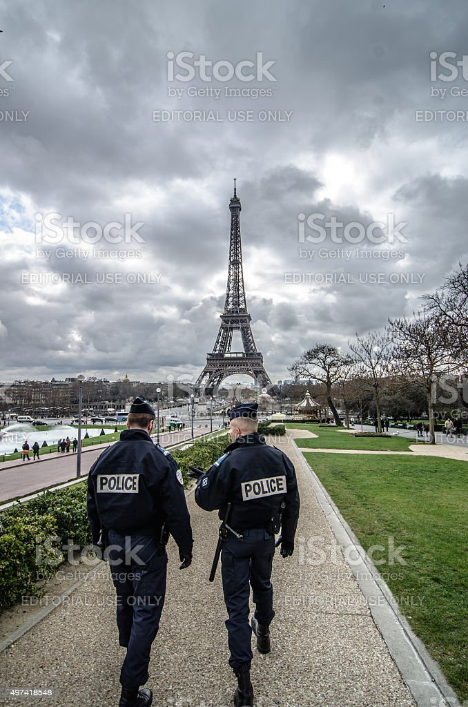 Police watch the Eiffel Tower in Paris, France stock photo