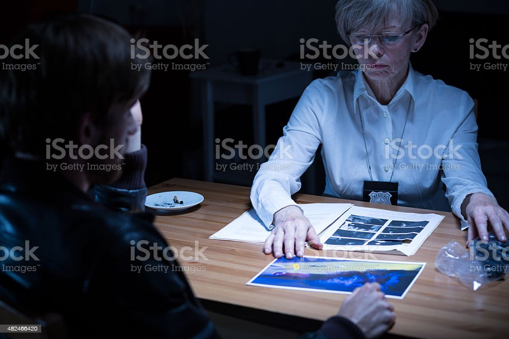 Police woman showing evidences stock photo