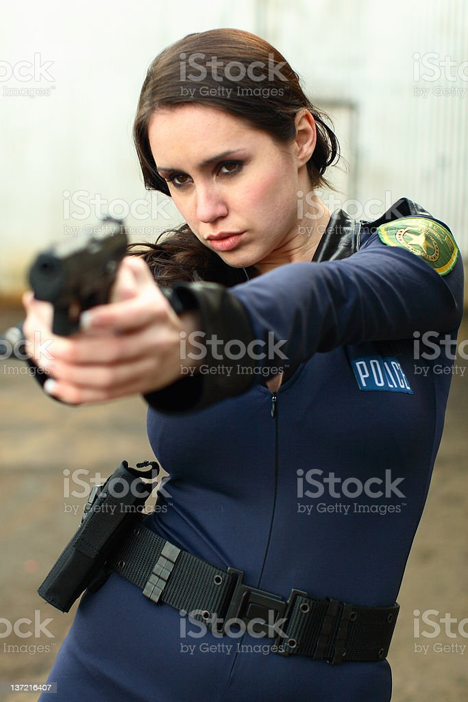Police woman with pistol stock photo