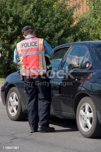 istock Police writing a speeding ticket 115907067